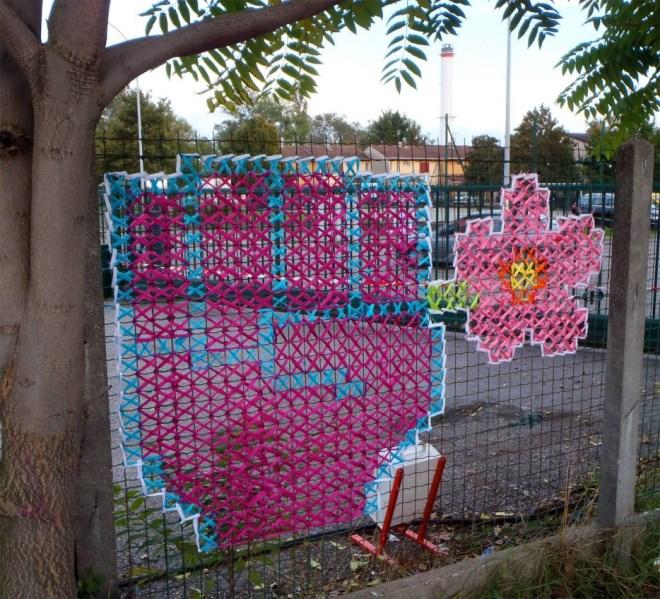 Yaratıcı-Street-Art-Cross-Dikiş-Resimleri-on-Çit-8.jpg