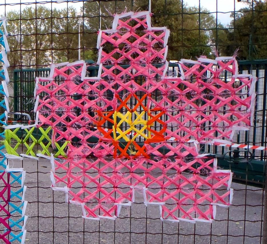 Creative street art cross stitch murals on fences for Creative mural designs