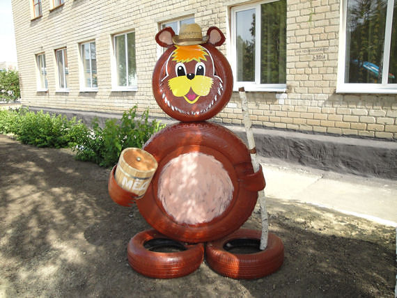 40+ Creative DIY Ideas to Repurpose Old Tire into Animal Shaped Garden Decor --> Tire Bear