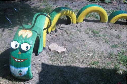 40+ Creative DIY Ideas to Repurpose Old Tire into Animal Shaped Garden Decor --> Tire Dragon