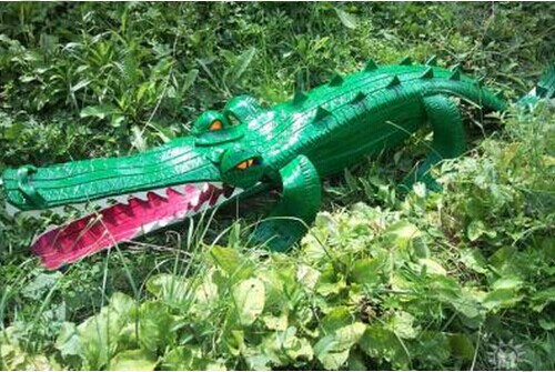 40+ Creative DIY Ideas to Repurpose Old Tire into Animal Shaped Garden Decor --> Tire Alligator
