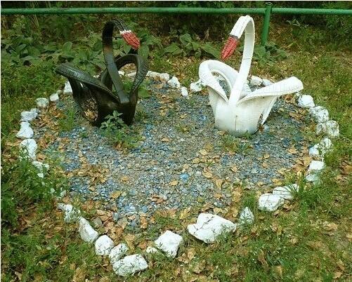 40+ Creative DIY Ideas to Repurpose Old Tire into Animal Shaped Garden Decor --> Tire Swans