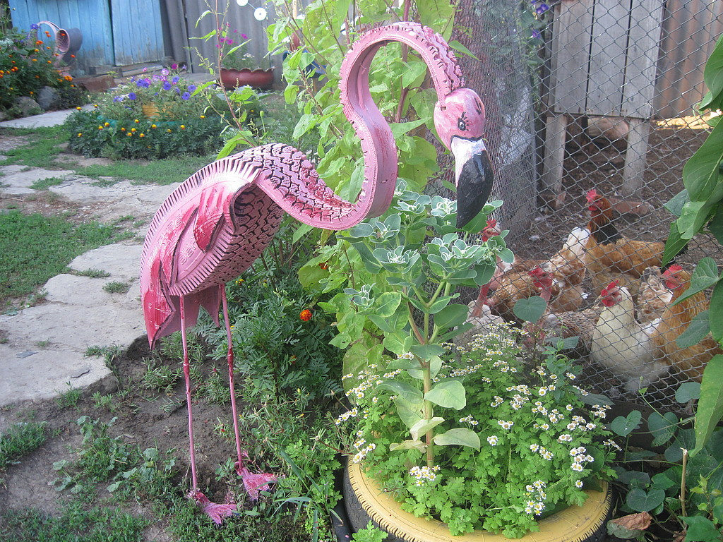 40+ Creative DIY Ideas to Repurpose Old Tire into Animal Shaped Garden Decor --> Tire Flamingo