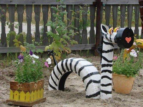 40+ Creative DIY Ideas to Repurpose Old Tire into Animal Shaped Garden Decor --> Tire Zebra