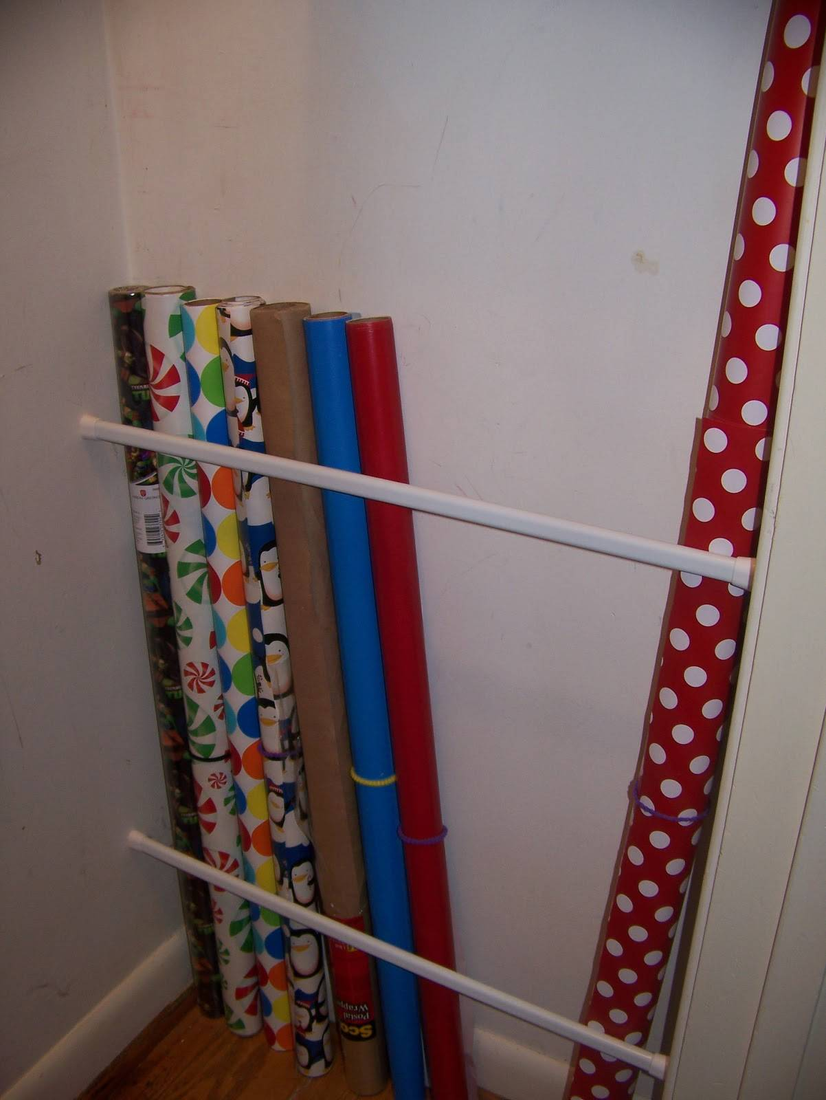 20+ Creative Uses of Tension Rods to Organize Your Home --> Use Tension Rod to Store Wrapping Paper Vertically and Keep Them Organized in the Closet