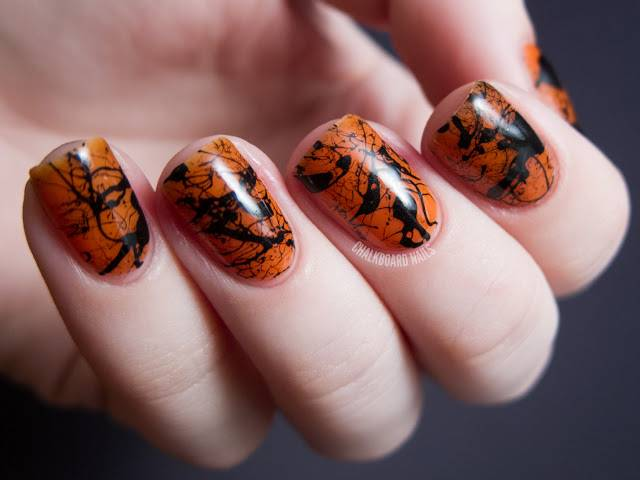 40+ Spooky and Creative DIY Halloween Nail Art Ideas --> Spooky Splatter Nails