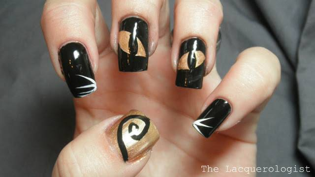 40+ Spooky and Creative DIY Halloween Nail Art Ideas --> Black Cat Nail Art