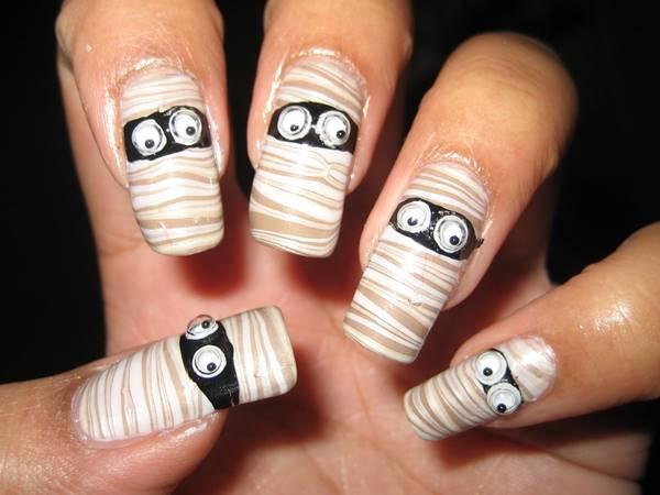 40+ Spooky and Creative DIY Halloween Nail Art Ideas --> Halloween Mummy Water Marble Nail Art