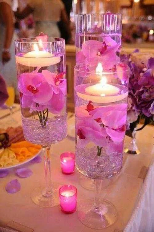 40+ Creative DIY Holiday Candles Projects --> Floating Candle Centerpiece With Flower