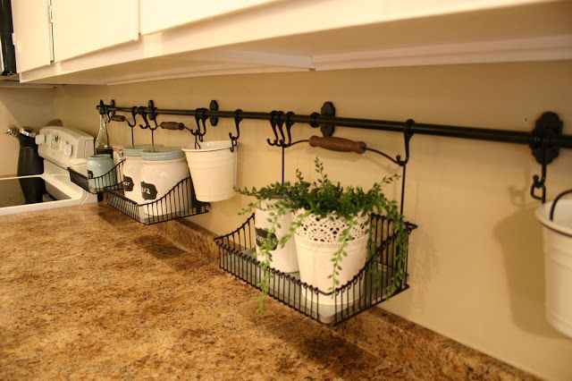 40+ Organization and Storage Hacks for Small Kitchens --> Install a railing system in the backsplash area that holds baskets for various kitchen items