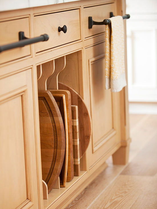 40+ Organization and Storage Hacks for Small Kitchens --> Convert a cabinet with dividers to store items that stack on their sides