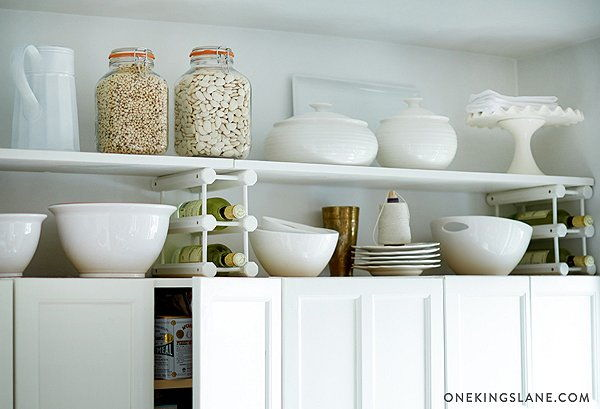 40+ Organization and Storage Hacks for Small Kitchens --> Add a simple wooden shelf on top of the existing cabinets