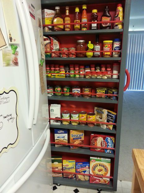 40+ Organization and Storage Hacks for Small Kitchens --> DIY roll-out pantry to take advantage of the empty space next to the refrigerator