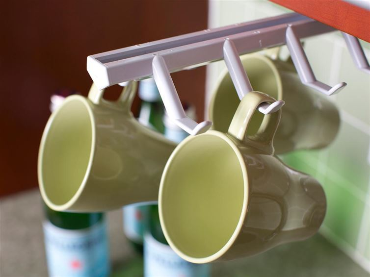 40+ Organization and Storage Hacks for Small Kitchens --> Use a cup holder to store cups vertically