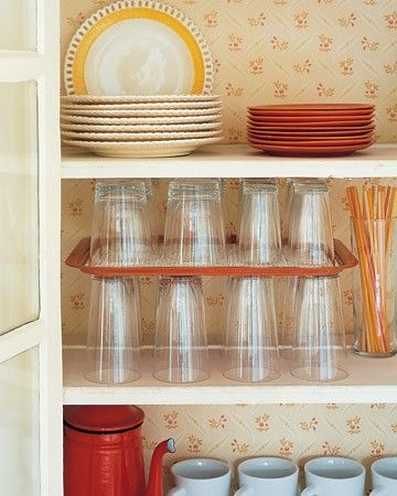 40+ Organization and Storage Hacks for Small Kitchens --> Increase cupboard space by using a serving tray as a shelf divider