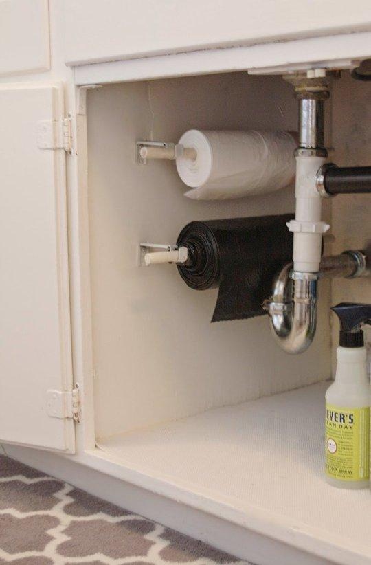 40+ Organization and Storage Hacks for Small Kitchens --> DIY trash bag organizer under the kitchen sink