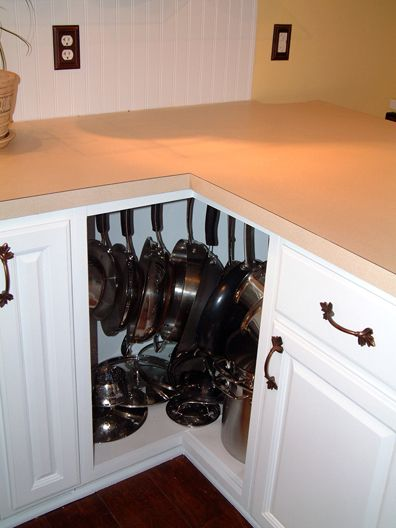 40+ Organization and Storage Hacks for Small Kitchens --> Turn awkward corner cabinet into a pot rack cabinet using hooks