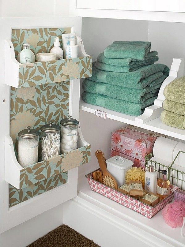 40+ Brilliant DIY Storage and Organization Hacks for Small Bathrooms --> Store linens in the cabinets under the sink