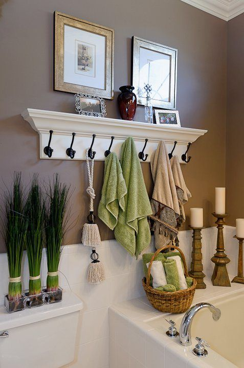 40+ Brilliant DIY Storage and Organization Hacks for Small Bathrooms --> Use coat hooks instead of a towel rod to hang more towels