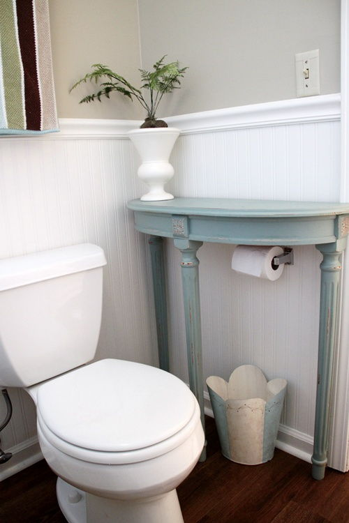 40+ Brilliant DIY Storage and Organization Hacks for Small Bathrooms --> Attach a half table over the toilet paper holder for extra storage
