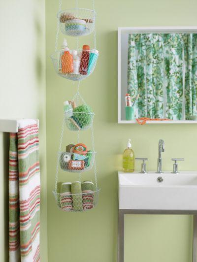 40+ Brilliant DIY Storage and Organization Hacks for Small Bathrooms --> Hanging basket bathroom storage