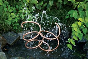 40+ Creative DIY Water Features For Your Garden --> DIY Copper Spiral Water Feature