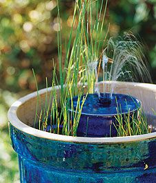 40+ Creative DIY Water Features For Your Garden --> Build a mini water garden oasis