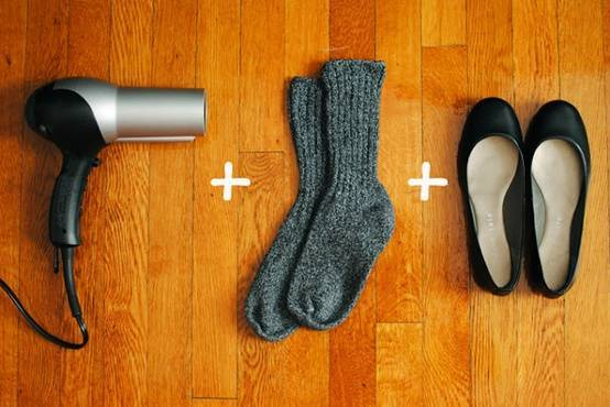 Stretch out tight shoes by putting them on with socks and blow with a hot hairdryer