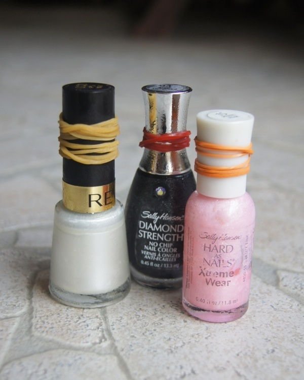 Use rubber bands to get more grip and easily open stuck nail polish bottles