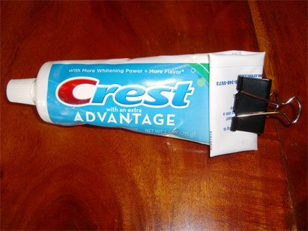 Use a binder clip as a toothpaste squeezer