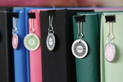 Use binder clips to hold customized label tags for your favorite photo albums or folders