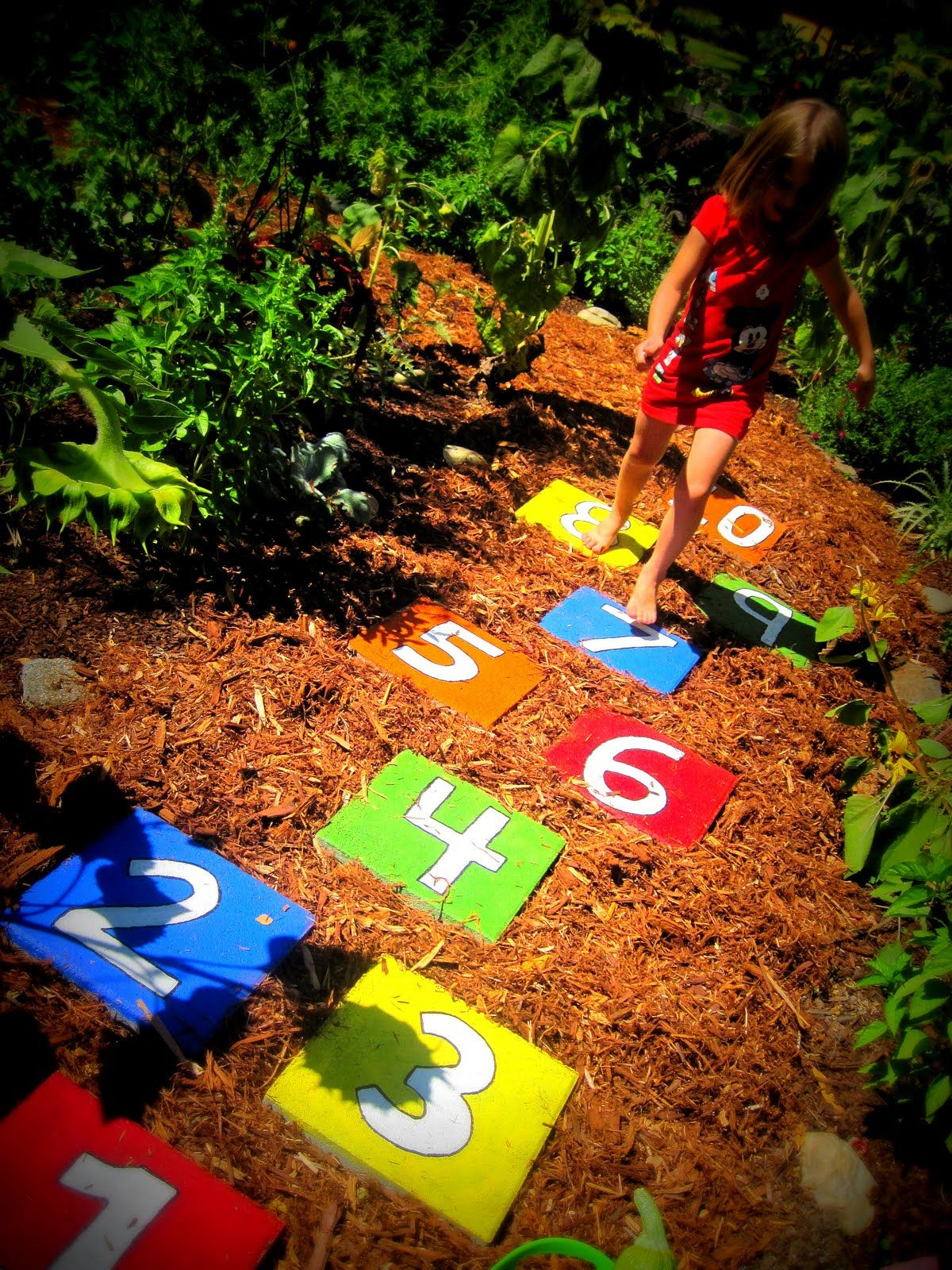 30 Beautiful DIY Stepping Stone Ideas to Decorate Your Garden --> Hopscotch Stepping Stones