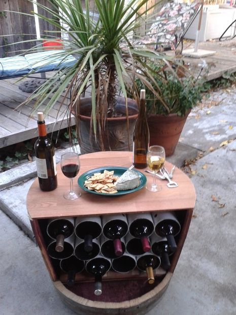 36+ Creative DIY Ideas to Upcycle Old Wine Barrels --> DIY Wine Barrel Wine Rack
