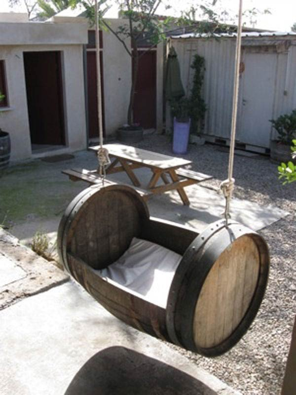 36+ Creative DIY Ideas to Upcycle Old Wine Barrels --> Wine Barrel Swing
