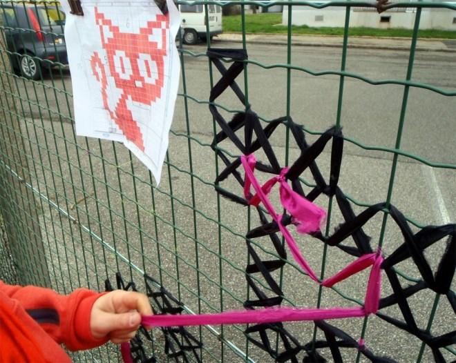 Creative-Street-Art-Cross-Stitch-Murals-on-Fences-1.jpg