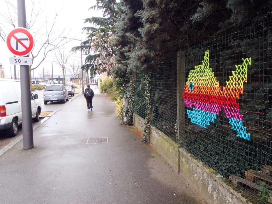 Creative Street Art - Cross-Stitch Murals on Fences
