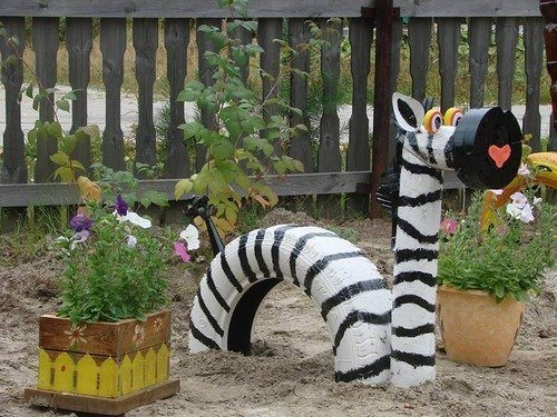 40+ Creative DIY Ideas to Repurpose Old Tire into Animal Shaped Garden Decor --> Tire Zebra