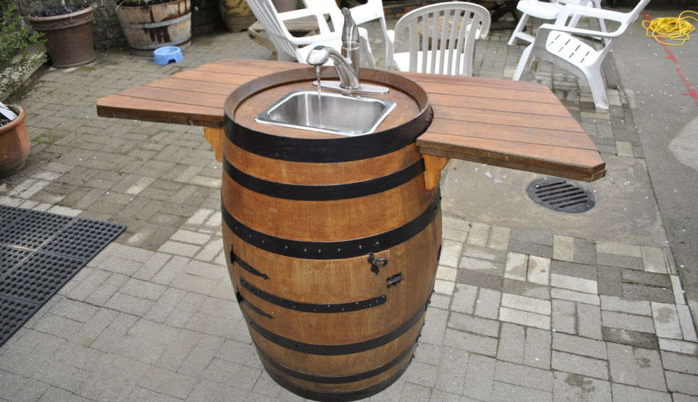 36+ Creative DIY Ideas to Upcycle Old Wine Barrels --> DIY Wine Barrel Sink