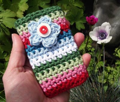 30 Stylish DIY Crochet Phone Cases --> Garden Flower Crocheted Mobile Phone Pocket