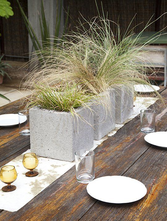 20+ Creative Uses of Concrete Blocks in Your Home and Garden --> Modern Grassy Centerpieces in Cinder Blocks