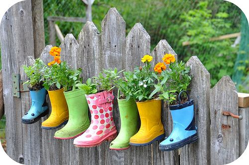 40+ Creative DIY Garden Containers and Planters from Recycled Materials --> Rain Boots Flower Planters