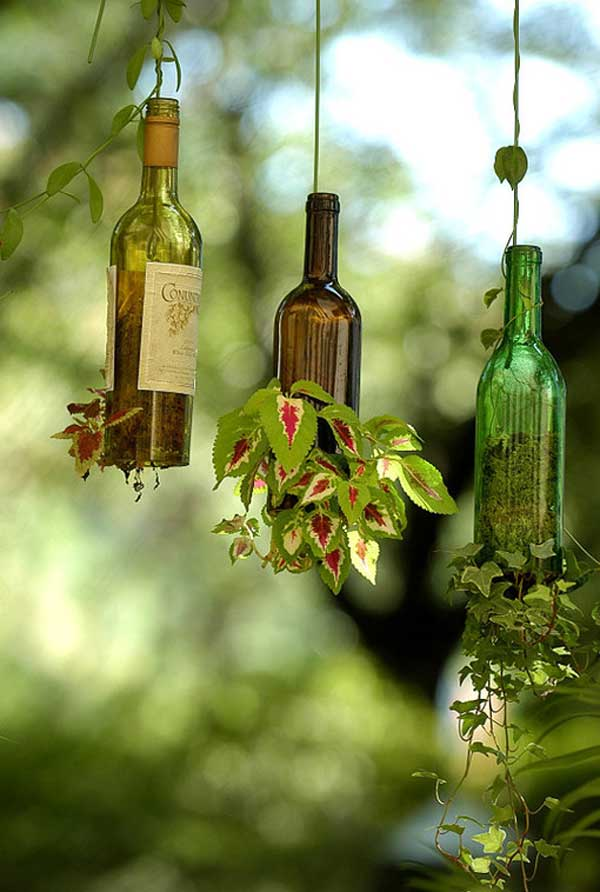 40+ Creative DIY Garden Containers and Planters from Recycled Materials --> Hanging Wine Bottle Garden Pots