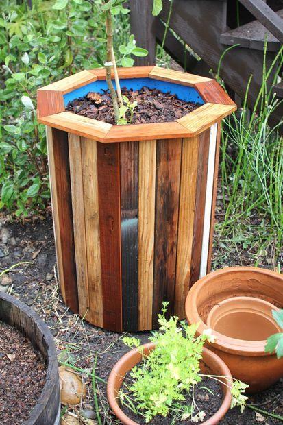 40+ Creative DIY Garden Containers and Planters from Recycled Materials --> DIY 55-Gallon Plastic Barrel Planter