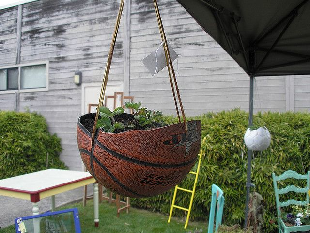 40+ Creative DIY Garden Containers and Planters from Recycled Materials --> Basketball Hanging Planter