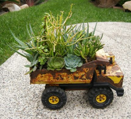 40+ Creative DIY Garden Containers and Planters from Recycled Materials --> Toy Truck Planters