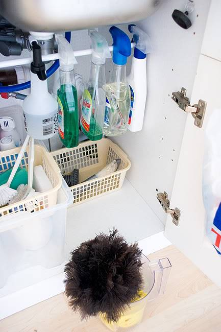 20+ Creative Uses of Tension Rods to Organize Your Home --> Use Tension Rod to Hang Cleaning Supplies Under The Sink