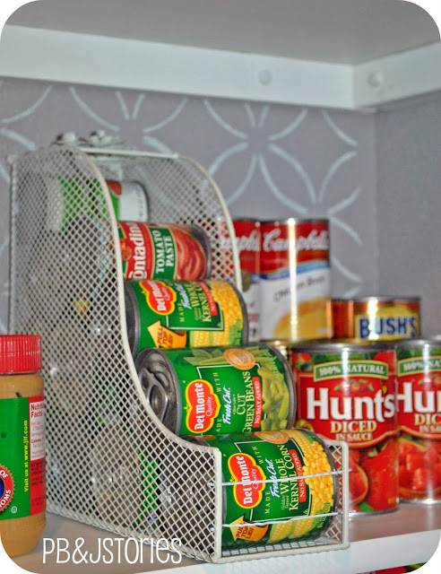 20+ Creative Uses for Magazine Holders to Organize Your Home --> Use a magazine holder to organize food cans in the pantry