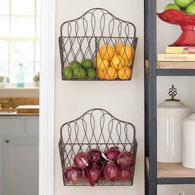 20+ Creative Uses for Magazine Holders to Organize Your Home --> Mount magazine racks on the wall to store fruits and produce to keep them fresh