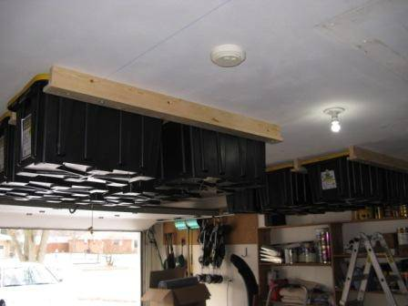 30+ Creative Ways to Organize Your Garage --> Install overhead storage for lighter items