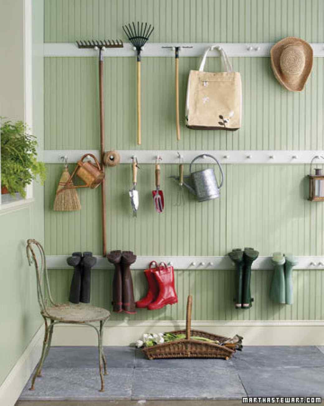 30+ Creative Ways to Organize Your Garage --> DIY peg-rail organizer to keep everything off the floor